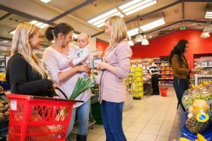 http://www.dreamstime.com/royalty-free-stock-image-mother-carrying-child-friends-shopping-image20185046