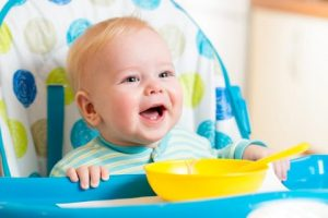 http://www.dreamstime.com/stock-image-smiling-baby-eating-food-kitchen-boy-image36333321